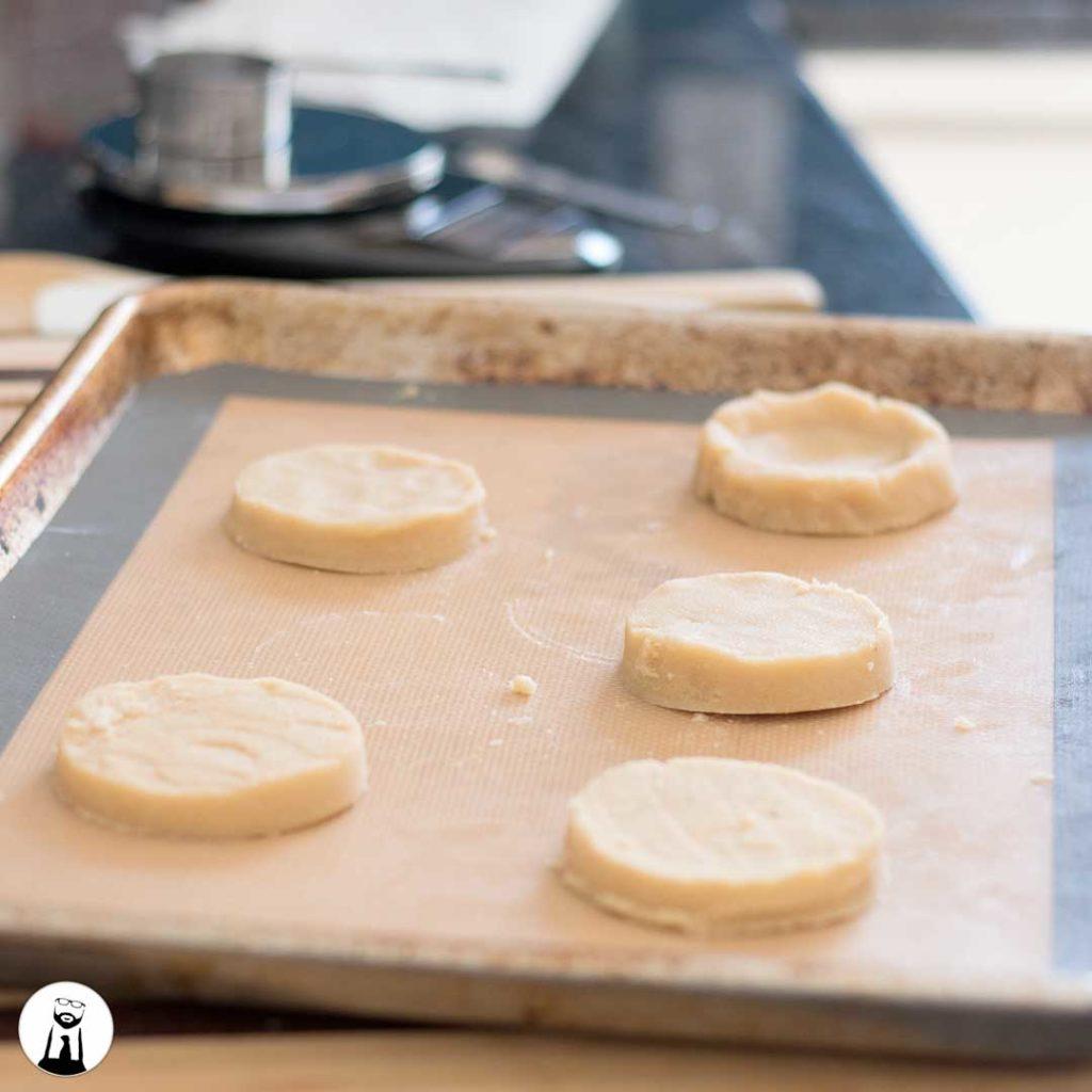 Raw sugar cookies on baking sheet