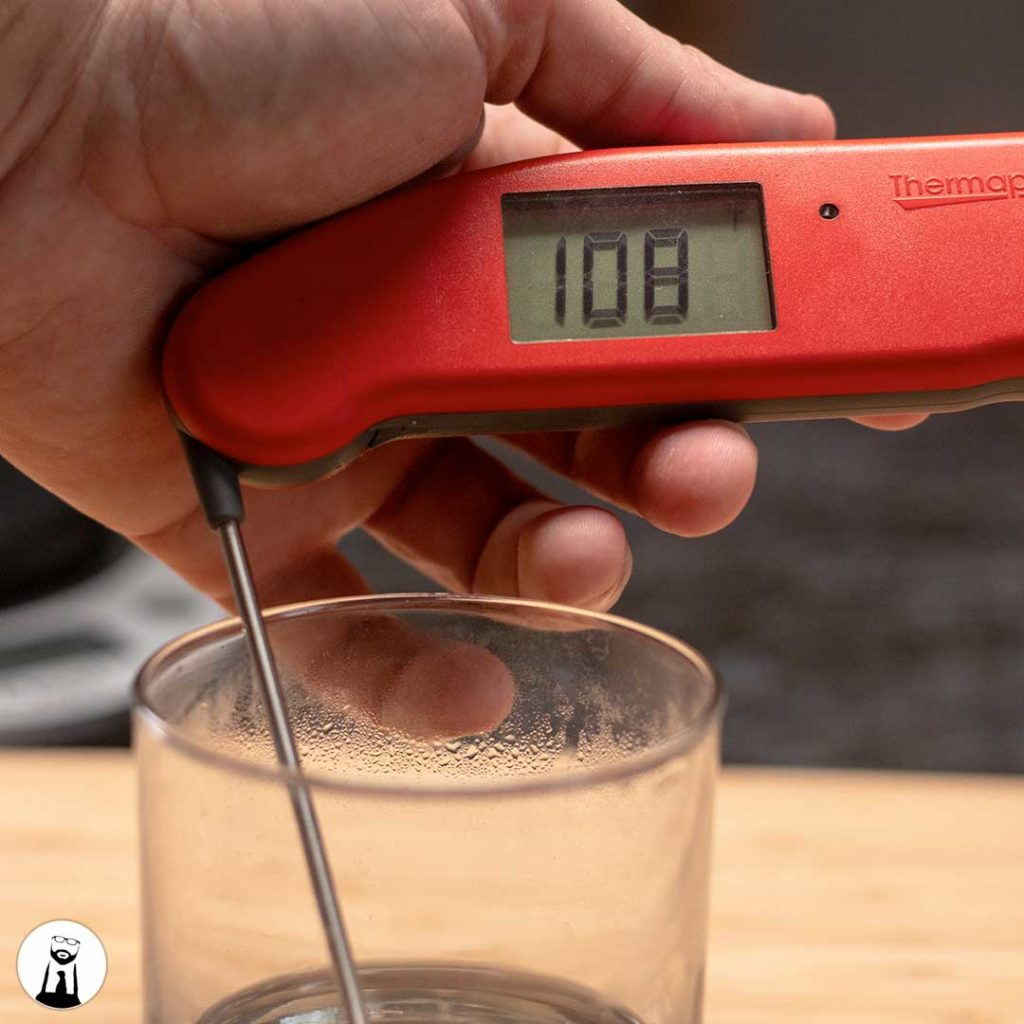 Checking the temperature of the sugar water - Black Tie Kitchen